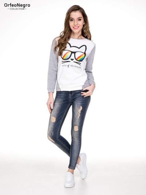 Ciemnoniebieskie rozjaśniane spodnie jeansowe rurki z przetarciami                                  zdj.                                  2