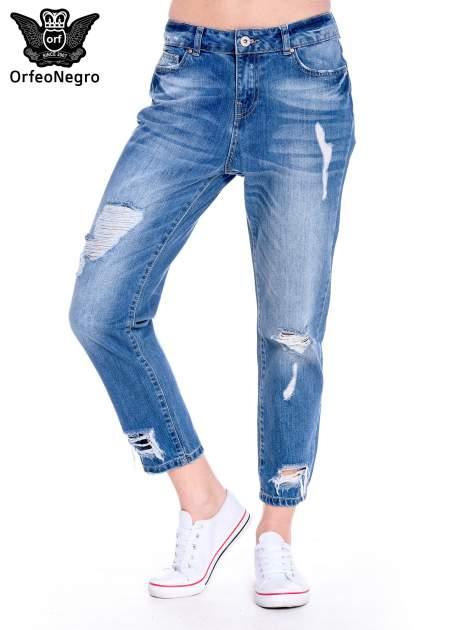 Ciemnoniebieskie spodnie boyfried jeans z dziurami