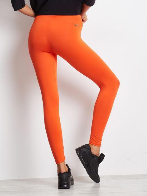 Ciemnopomarańczowe długie cienkie legginsy do biegania                              zdj.                              2