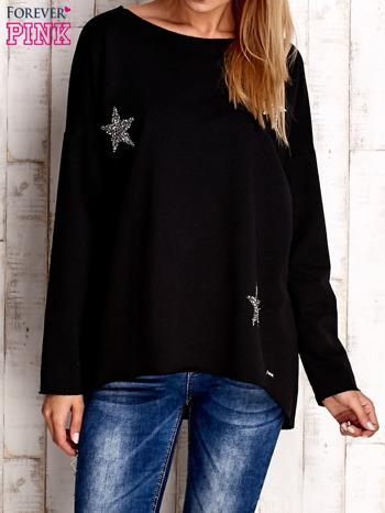 Czarna bluza z błyszczącymi gwiazdkami                                  zdj.                                  1