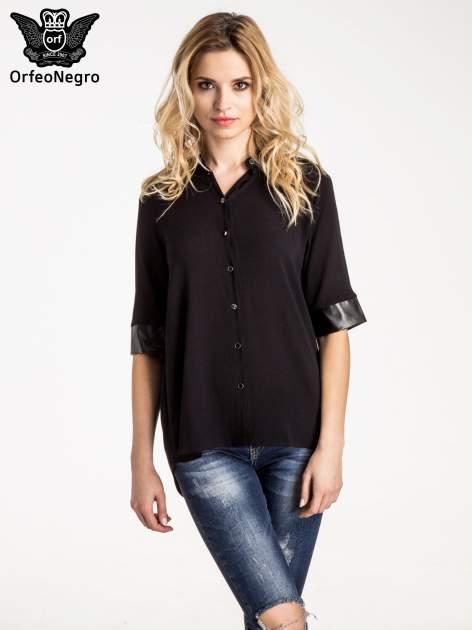 Czarna koszula ze skórzanymi mankietami