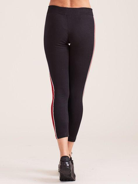 Czarne damskie legginsy z lampasami                              zdj.                              3