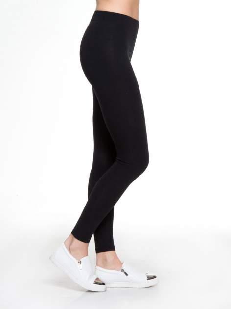 Czarne gładkie elastyczne legginsy                                  zdj.                                  3