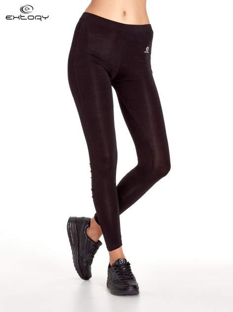 Czarne legginsy sportowe z drapowaniem                                  zdj.                                  1