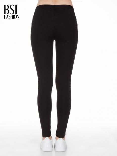 Czarne legginsy z lamapasami ze skóry                                  zdj.                                  5