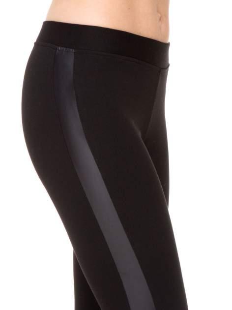 Czarne legginsy z lamapasami ze skóry                                  zdj.                                  6