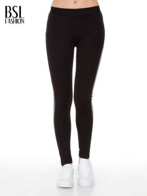 Czarne legginsy z lamapasami ze skóry                                  zdj.                                  3