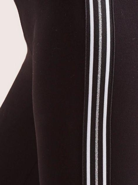 Czarne legginsy z lampasami                              zdj.                              6