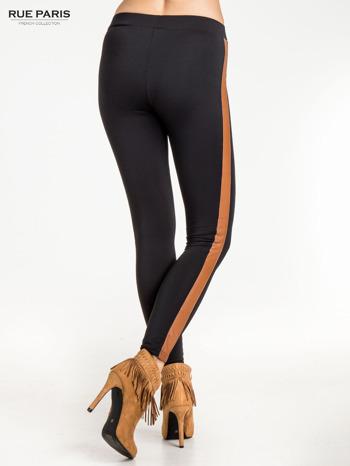 Czarne legginsy ze skórzanym lampasem                                  zdj.                                  4