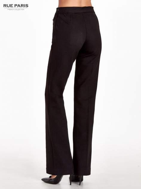 Czarne materiałowe spodnie dzwony w kant                                  zdj.                                  2
