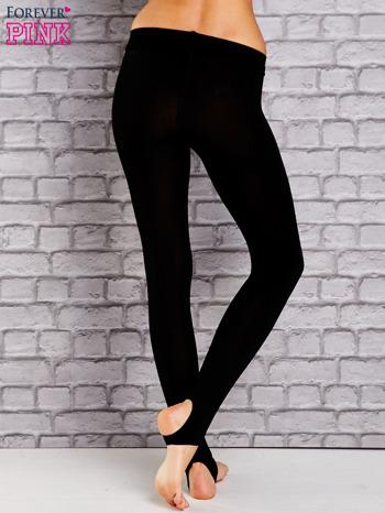 Czarne ocieplane legginsy zakładane na stopę                                  zdj.                                  3
