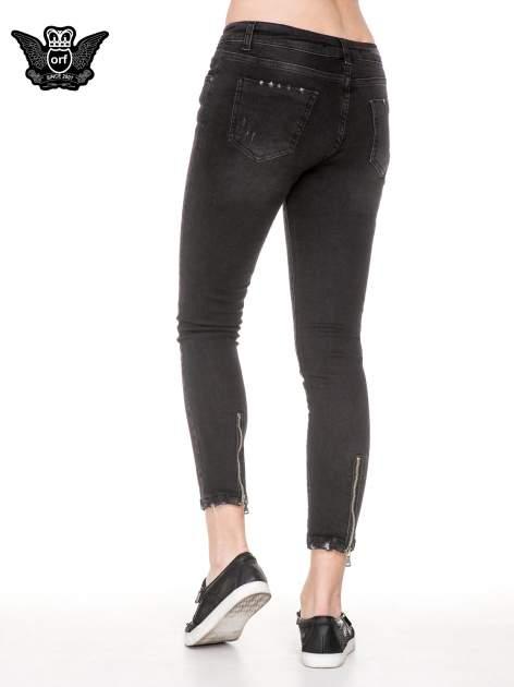 Czarne rozjaśniane spodnie jeansowe 7/8 z przetarciami                                  zdj.                                  4