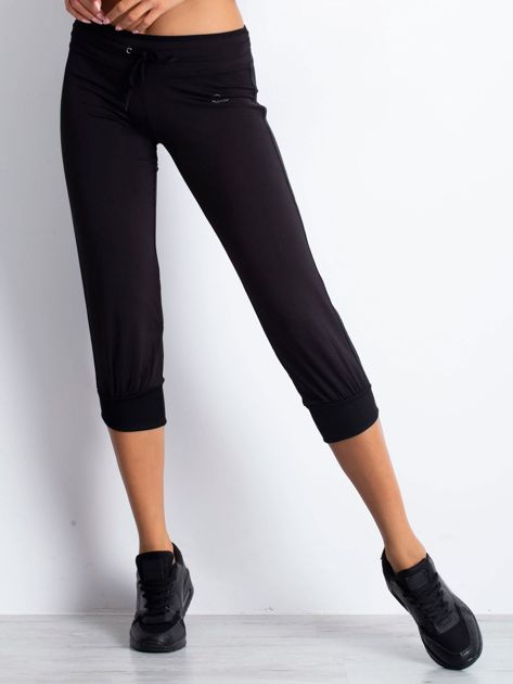 Czarne spodnie capri z troczkami