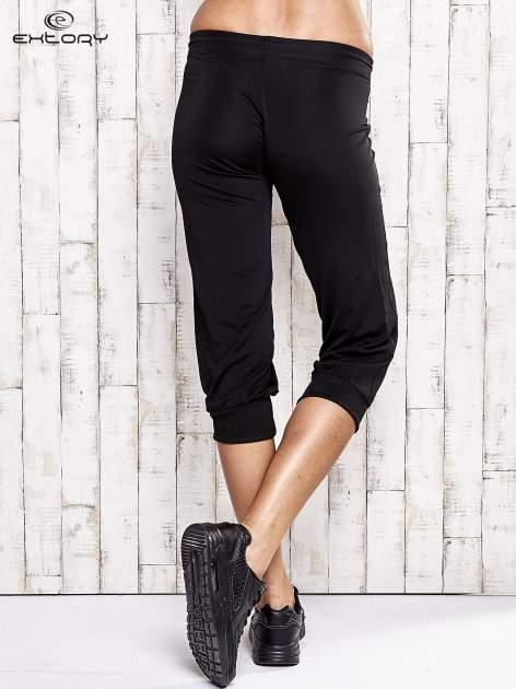 Czarne spodnie capri z wszytą kieszonką