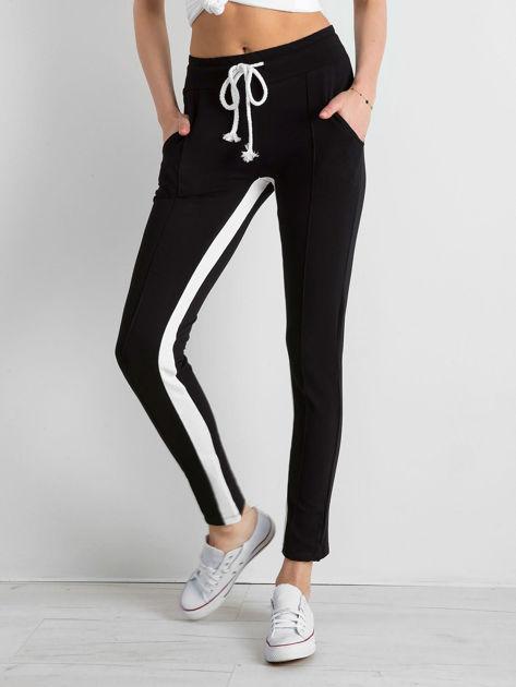 Czarne spodnie dresowe damskie Defined                              zdj.                              1