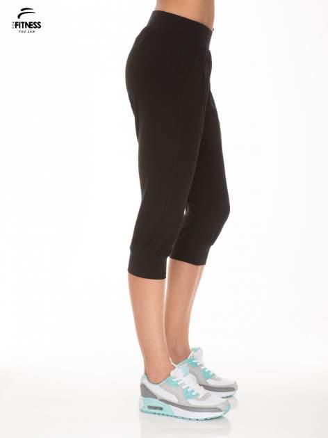 Czarne spodnie dresowe typu capri długości 3/4                                  zdj.                                  2