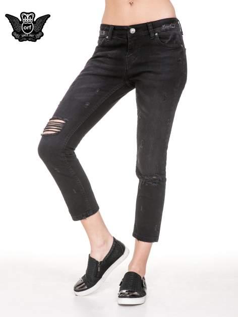 Czarne spodnie jeansowe 7/8 z rozdarciami                                  zdj.                                  1