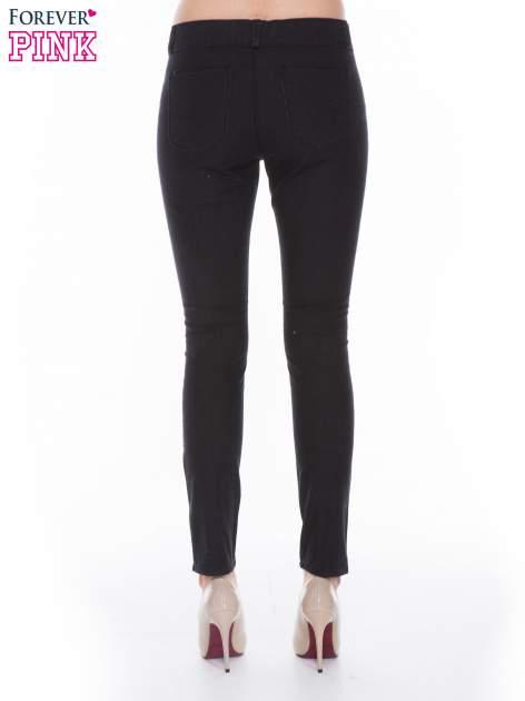 Czarne spodnie jeansowe typu skinny z suwakami na górze i przy nogawkach                                  zdj.                                  3