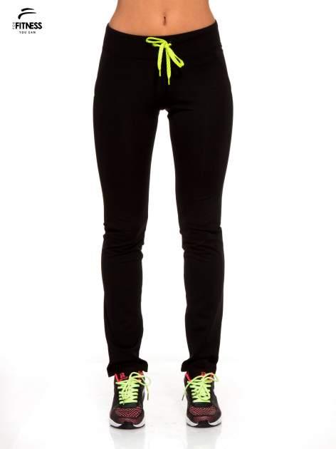 Czarne termoaktywne spodnie do biegania o prostej nogawce z fluozieloną wstawką ♦ Performance RUN                                  zdj.                                  1
