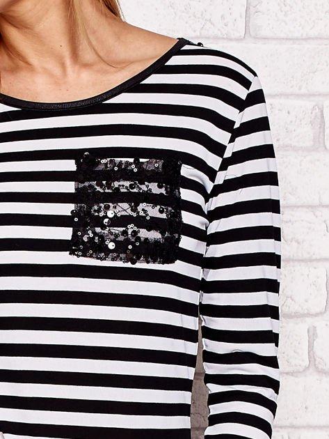 Czarno-biała bluzka w paski z cekinowymi motywami                              zdj.                              5