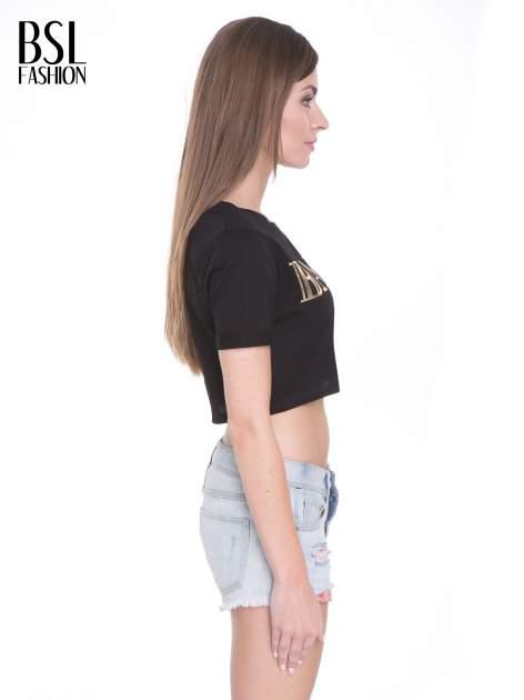 Czarny t-shirt typu crop top ze złotym napisem BALLIN PARIS                                  zdj.                                  3