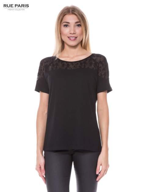 Czarny t-shirt z transparentną górą w kokardki                                  zdj.                                  1