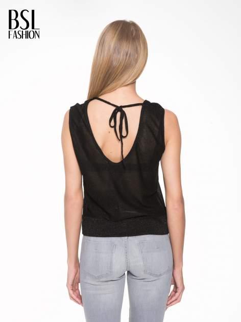 Czarny top z dekoltem na plecach przeplatany błyszczącą nicią                                  zdj.                                  2