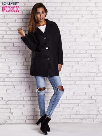 Czarny wełniany płaszcz z kieszeniami i kołnierzem                                  zdj.                                  5