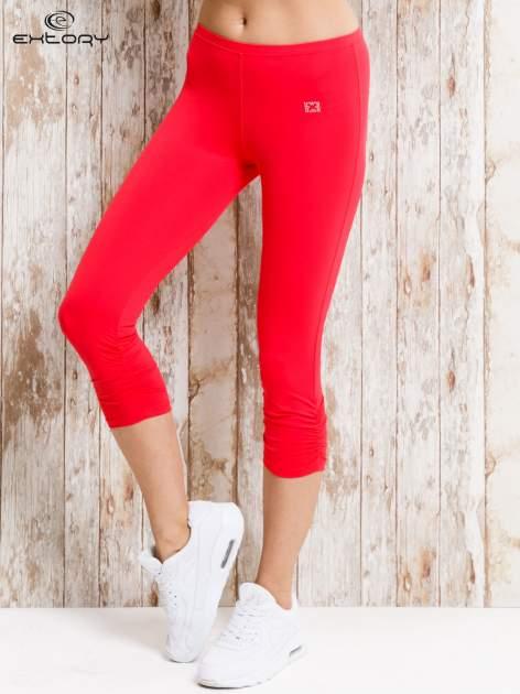 Czerwone legginsy sportowe 3/4 z marszczoną nogawką                                  zdj.                                  1