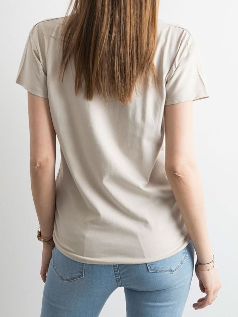 Damski beżowy t-shirt z aplikacją                              zdj.                              2