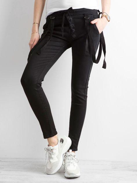 Damskie spodnie jeansowe czarne                              zdj.                              1