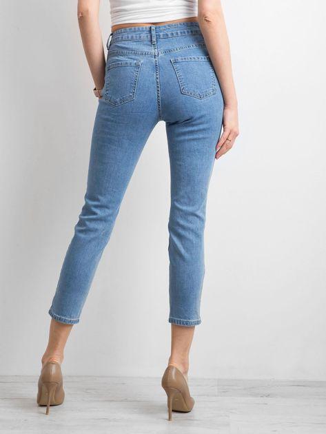 Damskie spodnie jeansowe z dziurami niebieskie                              zdj.                              2