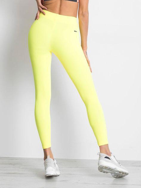 Długie fluo żółte legginsy fitness o średniej grubości                                zdj.                              2