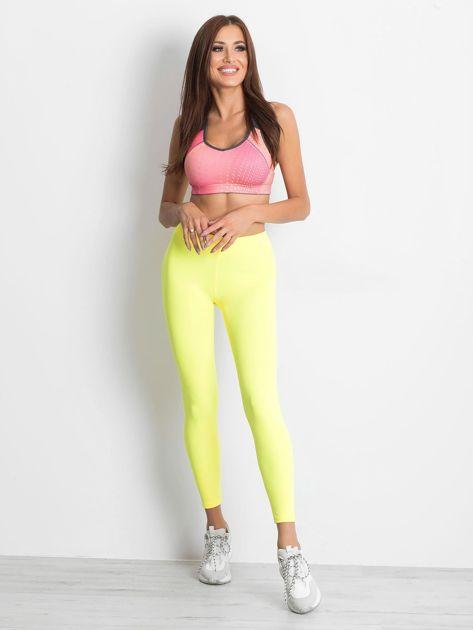 Długie fluo żółte legginsy fitness o średniej grubości                                zdj.                              4