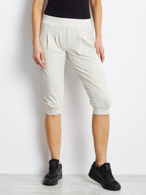 Ecru spodnie dresowe typu capri długości 3/4                                  zdj.                                  1