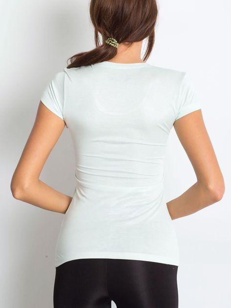 Ecru t-shirt z graficznym nadrukiem                              zdj.                              6