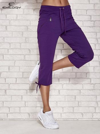 Fioletowe spodnie dresowe capri z kieszonką