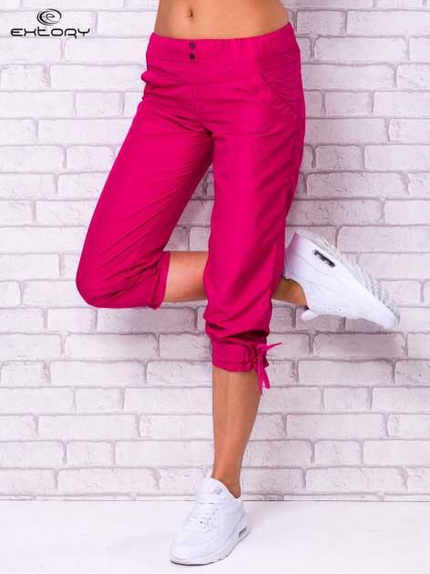 Fioletowe spodnie sportowe capri z guzikami                                  zdj.                                  1