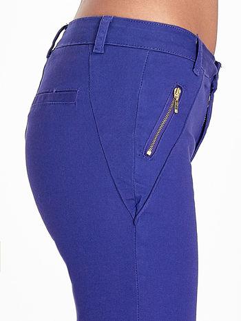 Fioletowe spodnie ze złotymi suwakami                                  zdj.                                  6