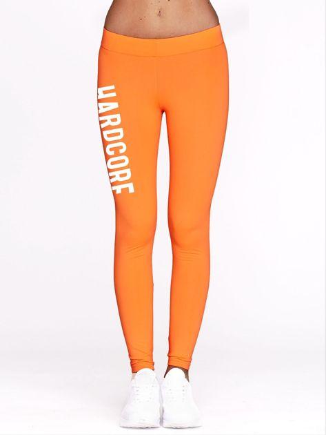 Fluo pomarańczowe legginsy do fitnessu z napisem HARDCORE                              zdj.                              2