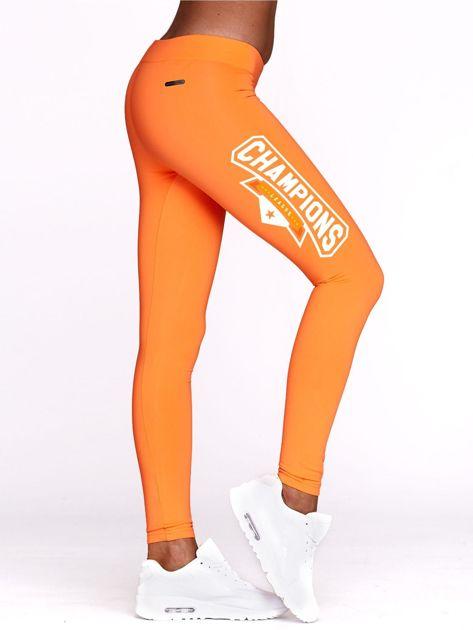 Fluo pomarańczowe legginsy na siłownię z nadrukiem CHAMPIONS                              zdj.                              1
