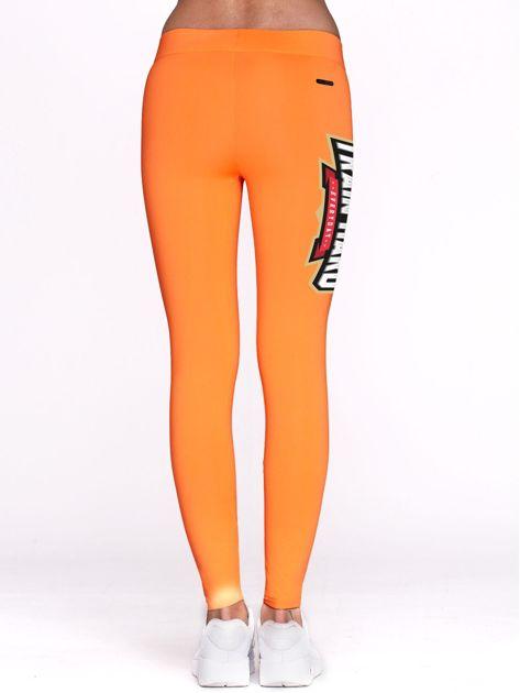 Fluo pomarańczowe legginsy treningowe z nadrukiem TRAIN HARD                                  zdj.                                  3