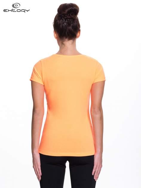Fluopomarańczowy t-shirt sportowy PLUS SIZE                                  zdj.                                  4