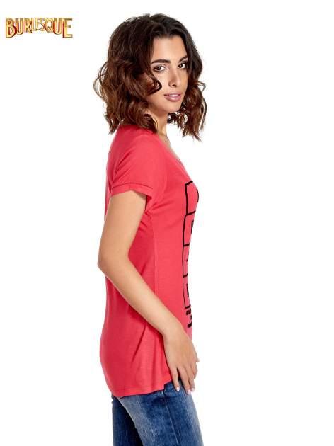 Fuksjowy t-shirt z napisem EVERY WOMAN IS A REBEL                                  zdj.                                  3