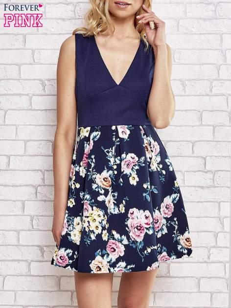 Granatowa sukienka z kwiatowym dołem i z suwakiem z tyłu                                  zdj.                                  1