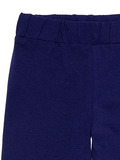 Granatowe legginsy dla dziewczynki z napisami                              zdj.                              8