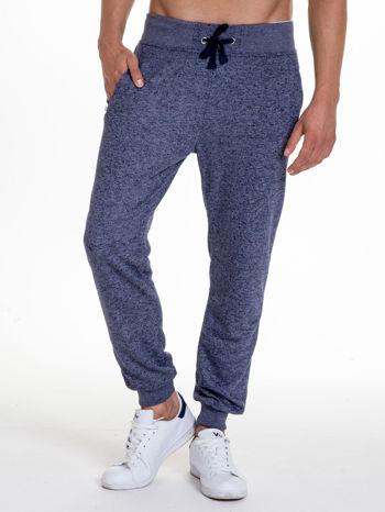 Granatowe melanżowe spodnie męskie z kieszeniami na suwak