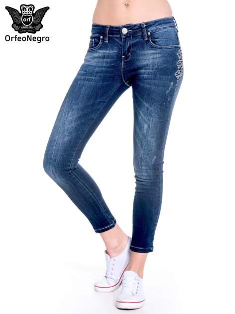 Granatowe spodnie skinny jeans z haftem                                  zdj.                                  1