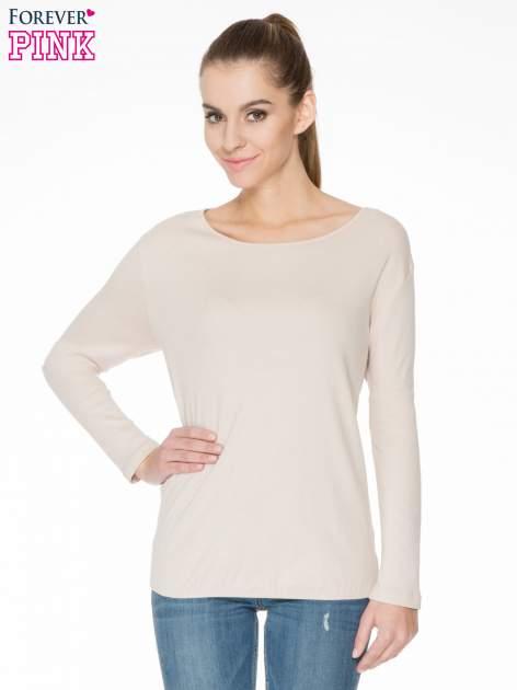 Jasnobeżowa bawełniana bluzka z gumką na dole