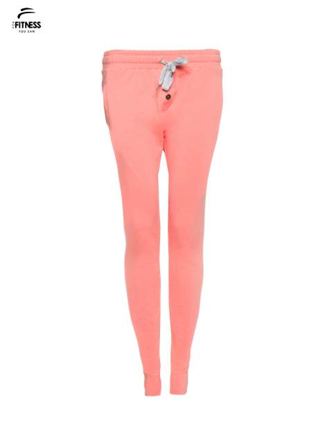 Jasnokoralowe spodnie dresowe typu baggy z guzikami                                  zdj.                                  4
